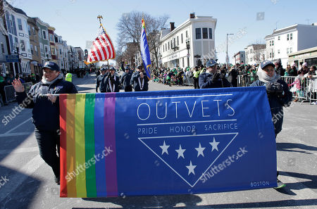 Members of OutVets, a group of gay military veterans, hold a banner and flags as they march in the annual St. Patrick's Day Parade, in Boston. Boston's popular St. Patrick's Day parade is all about veterans, but not all who've served in uniform were allowed to march in the parade. Veterans for Peace, the anti-war group, wasn't allowed to walk in Sunday's parade