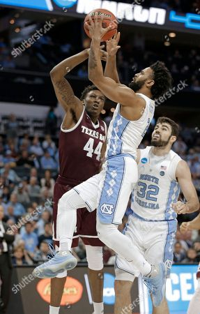Joel Berry II, Robert Williams. North Carolina's Joel Berry II, front, drives past Texas A&M's Robert Williams, back, during the first half of a second-round game in the NCAA men's college basketball tournament in Charlotte, N.C
