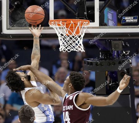 Joel Berry II, Robert Williams. North Carolina's Joel Berry II, left, shoots against Texas A&M's Robert Williams, right, during the first half of a second-round game in the NCAA men's college basketball tournament in Charlotte, N.C