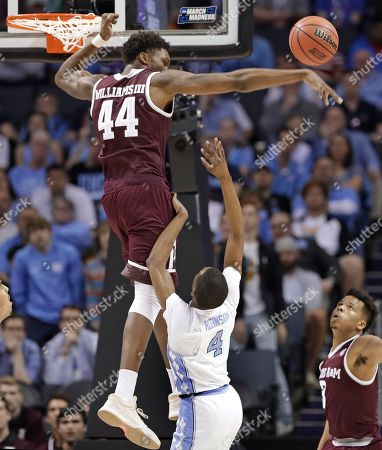 Robert Williams, Brandon Robinson. Texas A&M's Robert Williams (44) blocks a shot by North Carolina's Brandon Robinson (4) during the first half of a second-round game in the NCAA men's college basketball tournament in Charlotte, N.C