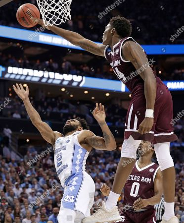 Joel Berry II, Robert Williams. Texas A&M's Robert Williams (44) blocks a shot by North Carolina's Joel Berry II (2) during the second half of a second-round game in the NCAA men's college basketball tournament in Charlotte, N.C