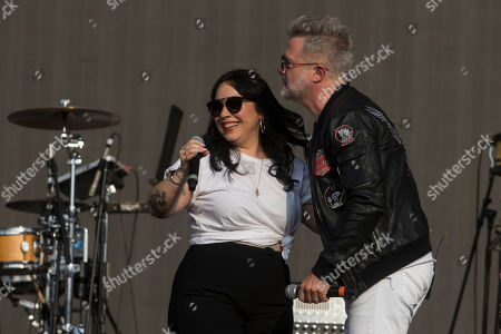 """Carla Morrison, Juanchi Baleiron. Mexican singer Carla Morrison, left, and Juanchi Baleiron of the Argentine band """"Los Pericos"""" perform during the Vive Latino music festival in Mexico City, . The two-day rock festival is one of the most important and longest running of Mexico"""