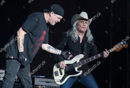 """Stock Image of Jose Fors, Carlos Aviles. Jose Fors, left, vocalist with the Mexican rock band """"La Cuca,"""" left, and bass guitarist Carlos Aviles perform at the Vive Latino music festival in Mexico City, . The two-day rock festival is one of the most important and longest running of Mexico"""