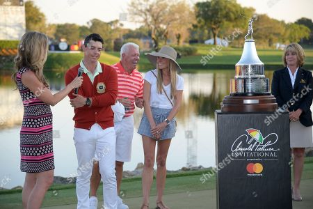 Kelly Tilghman, Erica Stoll, Gerry McIlroy, Rory McIlroy. Gerry McIlroy and Erica Stoll share a laugh as Kelly Tilghman, left, interviews Rory McIlroy, second from left, of Northern Ireland, during the trophy ceremony after winning the Arnold Palmer Invitational golf tournament, in Orlando, Fla