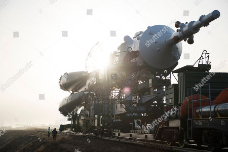 In this photo provided by NASA, the Soyuz rocket is rolled out by train to the launch pad at the Baikonur Cosmodrome in Kazakhstan. Expedition 55 crew members Ricky Arnold and Drew Feustel of NASA and Oleg Artemyev of Roscosmos are scheduled to launch on March 21 and will spend the next five months living and working aboard the International Space Station