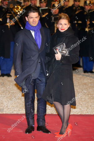 French cellist Gautier Capucon, left, and his wife Delphine Capucon arrive for a state dinner at the Elysee Palace in Paris, France, in honor of Grand Duke Henri of Luxembourg and Grand Duchess of Luxembourg Maria-Teresa