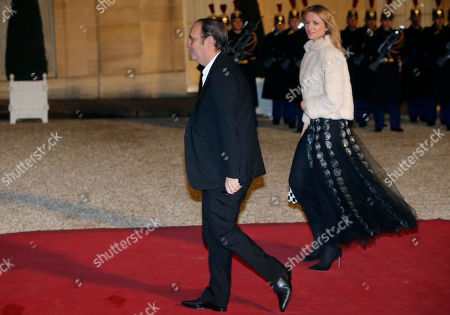 French broadband Internet provider Iliad CEO Xavier Niel, right, and his companion director and vice president of Louis Vutton, Delphine Arnault arrive for a state dinner at the Elysee Palace in Paris, France, in honor of Grand Duke Henri of Luxembourg and Grand Duchess of Luxembourg Maria-Teresa