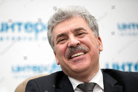Communist party candidate Pavel Grudinin smiles during a news conference in Moscow, Russia, . Grudinin, a millionaire strawberry farm director, polled 11.9 percent in Sunday's presidential vote, trailing far behind President Vladimir Putin who won nearly 77 percent of the vote