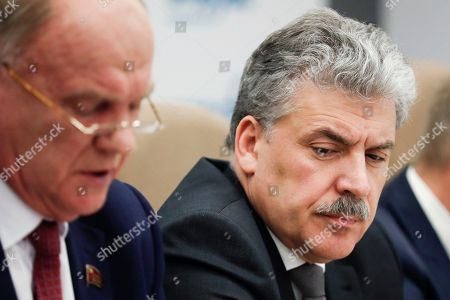 Communist party candidate Pavel Grudinin, right, and Communist Party leader Gennady Zyuganov, attend a news conference in Moscow, Russia, . Grudinin, a millionaire strawberry farm director, polled 11.9 percent in Sunday's presidential vote, trailing far behind President Vladimir Putin who won nearly 77 percent of the vote