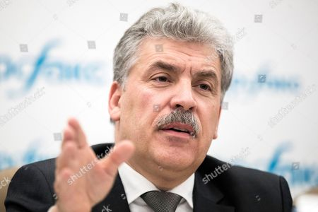 Communist party candidate Pavel Grudinin gestures during a news conference in Moscow, Russia, . Grudinin, a millionaire strawberry farm director, polled 11.9 percent in Sunday's presidential vote, trailing far behind President Vladimir Putin who won nearly 77 percent of the vote