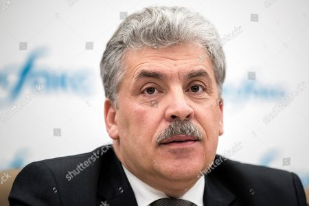Communist party candidate Pavel Grudinin attends a news conference in Moscow, Russia, . Grudinin, a millionaire strawberry farm director, polled 11.9 percent in Sunday's presidential vote, trailing far behind President Vladimir Putin who won nearly 77 percent of the vote
