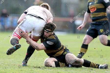 Dublin University vs Young Munster. Young Munster's Ger Slattery tackles Dublin University's Tom Ryan