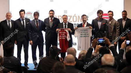 President of Real Madrid, Florentino Perez (C-L), and Arsenal Business Development Director Peter Silverstone (C-R) pose with former soccer players (L-R) Argentine Gallego and Santiago Solari, Spanish Raul Garcia, French Robert Pirres, Spanish Fernando Morientes, Spanish Jose Maria Gutierrez aka Guti and Brazilian Julio Baptista pose during the presentation of the Corazon Classic Match 2018 between Real Madrid Legends and Arsenal Legends at Santiago Bernabeu Stadium in Madrid, Spain, 19 March 2018. Real Madrid annually organizes the Corazon Classic Match to raise money for a charitable cause. Real Madrid Legends will face and Arsenal Legends in the Corazon Classic Match 2018 on the upcoming 03 June 2018.