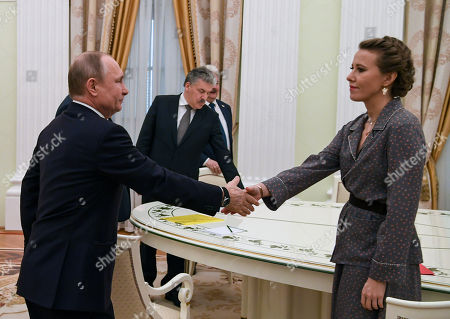 Russian President-elect Vladimir Putin welcomes Ksenia Sobchak (R), Pavel Grudinin and Sergei Baburin during a meeting with other candidates in the poll, a day after the presidential election, at the Kremlin in Moscow, Russia, 19 March 2018.