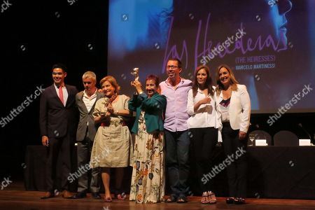 (L-R) the journalist and master of ceremonies of the event, Santiago Gonzalez; the producer of the film, Sebastian Pena; the actresses Ana Brun and Margarita Irun; the director of the film, Marcelo Martinessi; the actress Ana Ivanova and the journalist and master of ceremonies Mercedes Barriocanal, show the two Silver Bears that won the movie 'The Heiresses' (Las Herederas) in a meeting with the media at the Municipal Theater of Asuncion, Paraguay, 19 March 2018. 'The Heiresses' (Las Herederas), winner of two Silver Bears at the Berlinale, will premiere in Paraguay on April 5 to arrive later at the El Buen Pastor women's prison in Asuncion, one of the stages of this film.