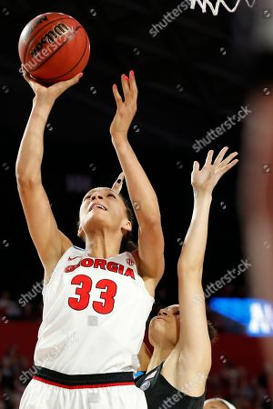 Georgia forward Mackenzie Engram (33) takes a shot while being defended by Duke guard/forward Faith Suggs (14) during the first half of a second-round game in the NCAA women's college basketball tournament in Athens, Ga