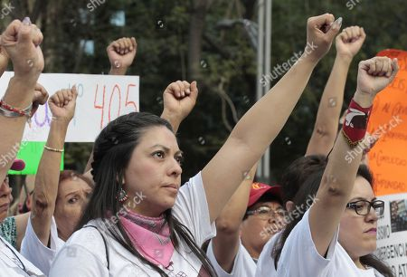 Earthquake victims demonstrate to demand support in Mexico City, Mexico, 19 March 2018.  The 7.1 magnitude earthquake hit on 19 September 2017 and left 366 dead, 238 of them in Mexico City.