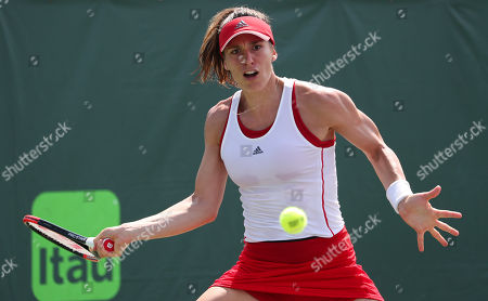 Andrea Petkovic from Germany plays against Sabine Lisicki from Germany during a qualifying round at the Miami Open presented by Itau professional tennis tournament, played at the Crandon Park Tennis Center in Key Biscayne, Florida, USA