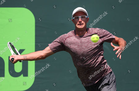 Peter Polansky from Canada in action against Reilly Opelka from the United States of America during a qualifying round at the Miami Open presented by Itau professional tennis tournament, played at the Crandon Park Tennis Center in Key Biscayne, Florida, USA