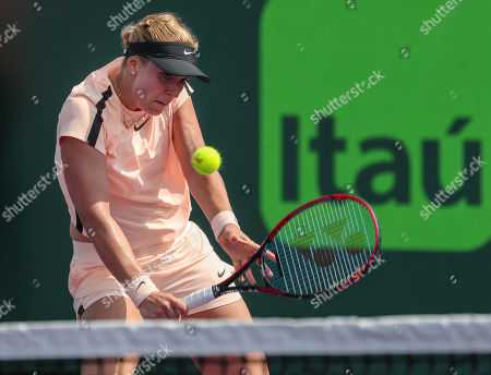 Sabine Lisicki from Germany plays a backhand volley against Andrea Petkovic from Germany during a qualifying round at the Miami Open by Itau professional tennis tournament, played at the Crandon Park Tennis Center in Key Biscayne, Florida, USA