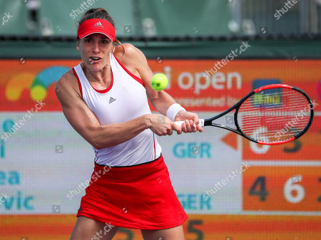 Andrea Petkovic from Germany hits a backhand against Sabine Lisicki from Germany during a qualifying round at the Miami Open presented by Itau professional tennis tournament, played at the Crandon Park Tennis Center in Key Biscayne, Florida, USA