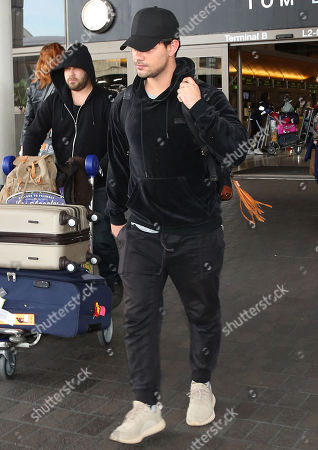 Editorial photo of Taylor Lautner at LAX International Airport, Los Angeles, USA - 19 Mar 2018