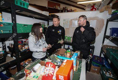 Stock Photo of Oldham manager Richie Wellens and Paul Terry during the EFL day of action at the Oldham Foodbank with volunteer Lauren Burgess