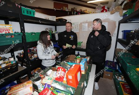 Stock Image of Oldham manager Richie Wellens and Paul Terry during the EFL day of action at the Oldham Foodbank with volunteer Lauren Burgess