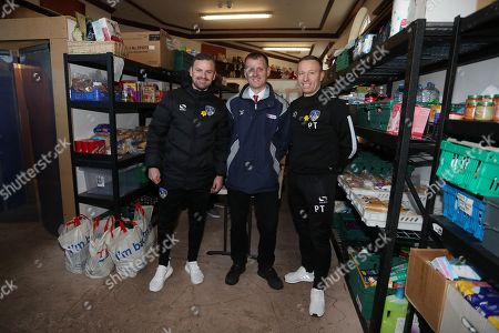 Oldham manager Richie Wellens and Paul Terry during the EFL day of action at the Oldham Foodbank with Director of Operations for the EFL trust Mike Evans