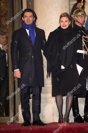 French cellist Gautier Capucon and Delphine Capucon attend a State dinner at the Elysee Palace in Paris