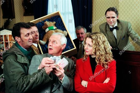 Ep 2478  Thursday 28th January 1999 About to make a killing at auction, devious Pollard's plans for the Steiff teddy bear he swindled from Ned are about to come to fruitation. But after a wake up call from Sarah, Ned has decided to pursue his childhood sweetheart, Dawn, who is flying out to Ibiza later that day. Collecting his things he notices the bear that belonged to his dead daughter Linda, is missing and following a series of clues tracks Pollard to the auction. Eric is helpless to argue over the destiny of the money it sells for, but will Ned make it to the airport on time? With Ned Glover, as played by Johnny Leeze ; Eric Pollard, as played by Christopher Chittell ; Stella Jones, as played by Stephanie Schonfield; Auctioneer, as played by Robert Pickavance.