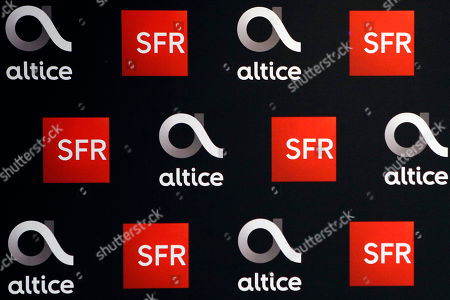 The logos of SFR and Alice is pictured prior to the arrival of Alain Weill, SFR Group Chairman and CEO of Altice Media for a news conference to present the SFR Altice 2017 results at their headquarters in Paris