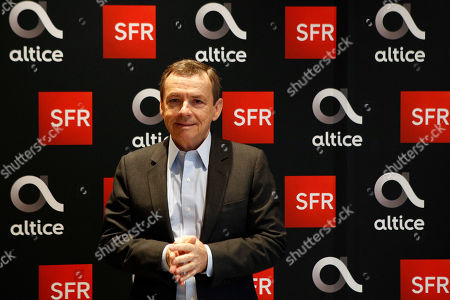 Alain Weill, SFR Group Chairman and CEO of Altice Media poses before a news conference to present the SFR Altice 2017 results at their headquarters in Paris