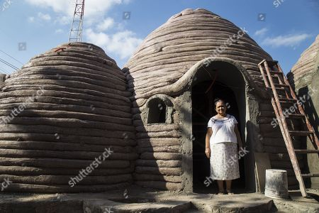 Mexican Teresa Guzman Antonio poses in what will be her new home built of clay, in the city of Ixtaltepec, in the southern state of Oaxaca, Mexico, 20 March 2018. The Mexican NGO Red Global Mx, designs and builds clay houses resistant to earthquakes of any magnitude for victims of the southern state of Oaxaca who have lost their homes due to an earthquake, said civil engineer in charge of the project, Filiberto Lara.
