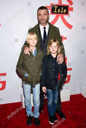 "Alexander Pete Schreiber, Liev Schreiber, Samuel Kai Schreiber. Actor Liev Schreiber, in background, and his sons, from left, Alexander Pete Schreiber and Samuel Kai Schreiber, attend a special screening of ""Isle of Dogs"" at the Metropolitan Museum of Art, in New York"