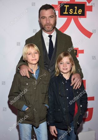 "Liev Schreiber, Alexander Pete Schreiber, Samuel Kai Schreiber. Liev Schreiber, in background, and his sons, from left, Alexander Pete Schreiber and Samuel Kai Schreiber, attend a special screening of ""Isle of Dogs"" at the Metropolitan Museum of Art, in New York"