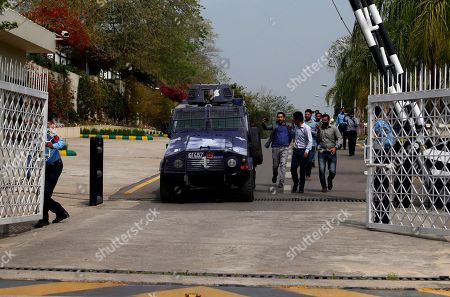 Pakistani journalists chase armored vehicle carrying Rao
