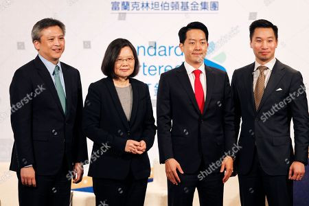 Stock Picture of Kin W. Moy, Tsai Ing-wen, Albert Chang, Alex Wong. Kin W. Moy, from left, director of the American Institute in Taiwan, Taiwan's President Tsai Ing-wen, Albert Chang, AmCham Chairman, and Alex Wong, Deputy Assistant Secretary at Bureau of East Asian and Pacific Affairs, U.S. Department of State pose for photographers, during the 2018 Hsieh Nien Fan of the American Chamber of Commerce in Taipei, Taiwan