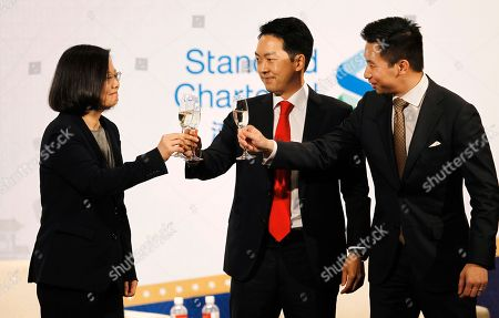 Stock Image of Tsai Ing-wen, Albert Chang, Alex Wong. Taiwan's President Tsai Ing-wen, from left, Albert Chang, AmCham Chairman, and Alex Wong, Deputy Assistant Secretary at Bureau of East Asian and Pacific Affairs, U.S. Department of State toast during the 2018 Hsieh Nien Fan of the American Chamber of Commerce in Taipei, Taiwan