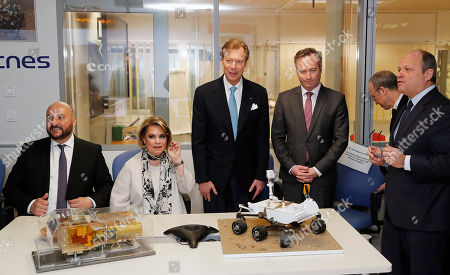 (L-R) Deputy prime minister of Luxembourg Etienne Schneider, Grand Duchess Maria-Teresa of Luxembourg, Grand Duke Henri of Luxembourg and French Junior Minister in charge of European affairs Jean-Baptiste Lemoyne, Lionel Suchet second director of the CNES attend a visit at the National Centre for Space Studies (CNES) in Toulouse, Southern France, 21 March 2018.