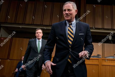 Mark Warner, Richard Burr. Senate Intelligence Committee Vice Chairman Mark Warner, D-Va., left, and Chairman Richard Burr, R-N.C., right, arrive to greet Homeland Security Secretary Kirstjen Nielsen and former Homeland Security Secretary Jeh Johnson as they appear before a Senate Intelligence Committee hearing on election security on Capitol Hill in Washington