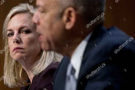 Kirstjen Nielsen, Jeh Johnson. Former Homeland Security Secretary Jeh Johnson, right, accompanied by Homeland Security Secretary Kirstjen Nielsen, left, testifies at a Senate Intelligence Committee hearing on election security on Capitol Hill in Washington