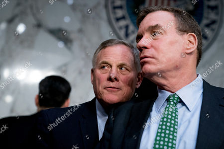 Mark Warner, Richard Burr. Senate Intelligence Chairman Richard Burr, R-N.C., left, speaks with Committee Vice Chairman Mark Warner, D-Va., right, following testimony from Homeland Security Secretary Kirstjen Nielsen and former Homeland Security Secretary Jeh Johnson at a Senate Intelligence Committee hearing on election security on Capitol Hill in Washington