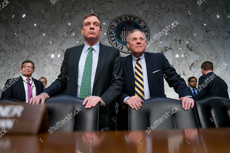 Mark Warner, Richard Burr. Senate Intelligence Chairman Richard Burr, R-N.C., right, and Committee Vice Chairman Mark Warner, D-Va., left, stand following testimony from Homeland Security Secretary Kirstjen Nielsen and former Homeland Security Secretary Jeh Johnson at a Senate Intelligence Committee hearing on election security on Capitol Hill in Washington