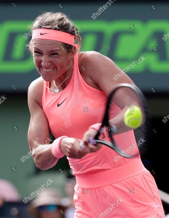 Victoria Azarenka, of Belarus, returns to Catherine Bellis during the Miami Open tennis tournament, in Key Biscayne, Fla. Azarenka won 6-3, 6-0