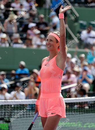 Victoria Azarenka, of Belarus, waves after defeating Catherine Bellis at the Miami Open tennis tournament, in Key Biscayne, Fla. Azarenka won 6-3, 6-0
