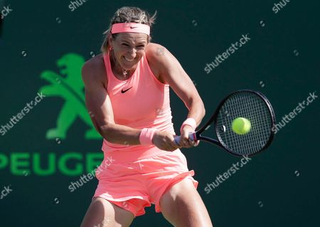 Victoria Azarenka of Belarus, returns to Catherine Bellis during the Miami Open tennis tournament, in Key Biscayne, Fla