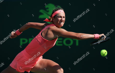 Victoria Azarenka from Belarus chases a ball during her match against Catherine Bellis from the United States of America during a first round of the Miami Open presented by Itau professional tennis tournament, played at the Crandon Park Tennis Center in Key Biscayne, Florida, USA. Azarenka won 6-3, 6-0