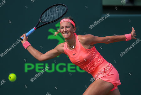 Victoria Azarenka from Belarus plays a forehand against Catherine Bellis from the United States of America during a first round of the Miami Open presented by Itau professional tennis tournament, played at the Crandon Park Tennis Center in Key Biscayne, Florida, USA. Azarenka won 6-3, 6-0