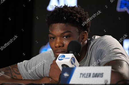 Texas A&M forward Robert Williams listens to questions during a news conference at the NCAA men's college basketball tournament, in Los Angeles. Texas A&M plays Michigan in a regional semifinal on Thursday